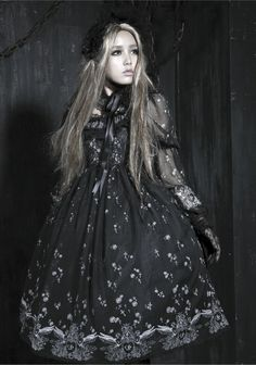 A Gothic Lolita of Harajuku. The edgy darkness of Victorian gothic styles clubbed with the frills and flourish of the Lolita style. Much easier on my eye!