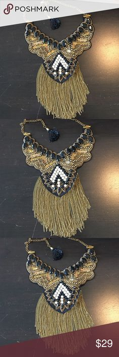"""Statement Necklace Black / Gold W/ Rhinestones Statement Necklace Black / Gold W/ Rhinestones , sequined and Rhinestones very majestic jewelry. Approximately 16"""" long with a 3"""" extension with black tassel on the end.  Never been worn. Jewelry Necklaces"""