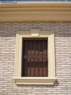 Recercados con molduras de piedra artificial para puertas - Molduras para paredes exteriores ...