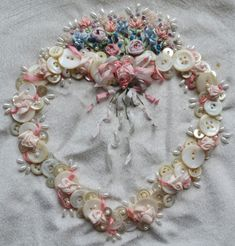 silk ribbon embroidery border patterns - Google Search I have a collection of buttons from my Mother-in-law and am thinking of creating something using them with ribbon embroidery to create something for each of my Grand-treasures! This gives me an idea!