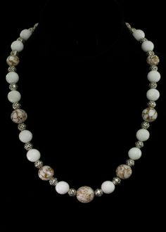 "White Marble Agate Necklace  21"""" White faceted agate beads and brown and white marble look agate beads, sterling silver beads and toggle clasp.   http://www.sterlingjewelrystores.com/product607.html"