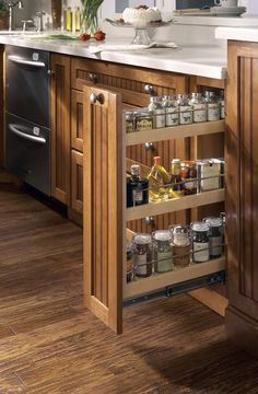 built in spice rack pull out cabinet adjusting shelves | This pull-out spice rack features three shelves on full-extension ...