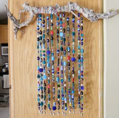 This colorful Sun Catcher/Wind Chime has twelve rows of beautiful lamp work ,Chinese Crystal and different kinds of glass beads. Each row is 25 inches long and has about 45 to 50 beads. They hang from a piece of natural wood. The wood piece is 2 inches wide and weighs about 5.5 lbs. I used strong stainless steel wire to string the beads. For each strand I used different color seed beads to hang from the wood. The strands are finished with silver bells.