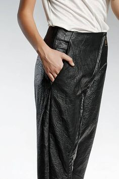 ITEM DETAILS: ARYA These womens eco leather pants have the perfect silhouette and fit thanks to their extremely original and nonconventional construction. The leather pants have a front antique zipper, two front pockets and one back. Its style is inspired by the North African
