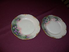 """Set of Two Handpainted Plates in grannys' Garage Sale allen, TX for $15.00. this is a set of two handpainted plates 8 1/2"""" diameter the are painted in very pale grey green with tiny purple forget me nots each plate is edged in gold leaf they are marked Bavaria, Germany on the back there are some very slight rubbed areas on the gold leaf, but this does not effect the overall beauty"""