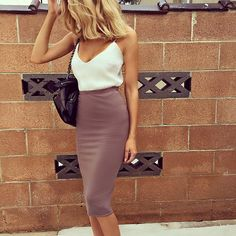 White, thin-strapped top tucked inside taupe pencil-skirt