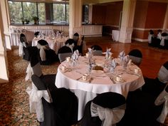 Black Chair Covers available for rent with Silver Organza Bows in Seal Beach - Special Event Linens