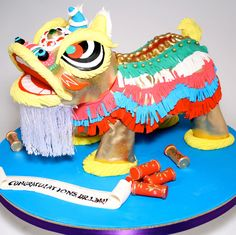 Charm City Cakes Sculpted cake of a Chinese dragon with firecrackers and message.