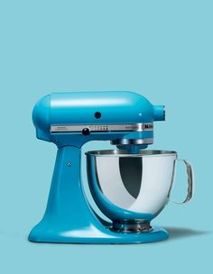 KitchenAid Artisan stand mixer in crystal blue. Visit johnlewis.com