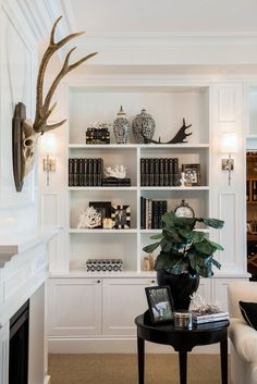 bookshelf in living room. Built in look  white from ceiling to floor moulding create detail perhaps for end panel cornice at top Consider shiplap coastal bookshelf styling dayme walther Love This Look Pinterest