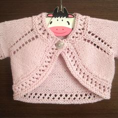A super cute and quick-to-knit bolero with a pretty eyelet lace edging. A super cute and easy to knit bolero with a pretty lace top. Available with 2 other sweet boleros from the Sugar & Spice Bolero collection. Baby Sweater Patterns, Baby Knitting Patterns, Baby Patterns, Crochet Patterns, Baby Cardigan Knitting Pattern, Romper Pattern, Amigurumi Patterns, Baby Girl Cardigans, Girls Sweaters
