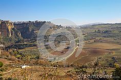 Photo about A view upon Ronda surrounding plains taken in december 2015 around Christmas time. It s a MUST-VISIT place if you like to hike! Image of farm, evening, landmark - 70321446 Andalusia Spain, Christmas Time, Grand Canyon, December, Hiking, Stock Photos, Places, Travel, Image