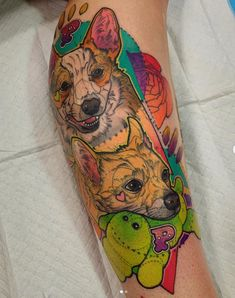 Two colorful corgis in this colorful Katie Shocrylas tattoo. See more pupper tattoos at the link!