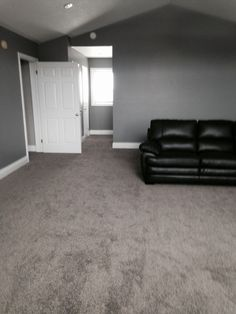 High piled Frise Carpet in a Great Room. – Loving the dark grey carpet with the deep grey walls. Carpeting continues into hallway, bedroom, and stairs. Carpeting was purchased and installed through Floors In Motion Visit our website: www. Grey Walls And Carpet, Dark Carpet, Brown Carpet, White Carpet, Gray Walls, Color Walls, Modern Carpet, Wall Colors, Bedroom Carpet
