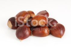 Small group of chestnuts on white royalty-free stock photo #chestnut #autumn