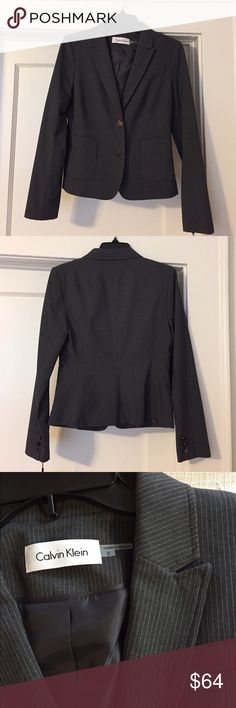 """Calvin Klein Pinstripe Blazer Calvin Klein Charcoal & White Pinstripe Blazer, Size 2. Polyester/rayon; lining: polyester Dry clean Front button closures, Long sleeves Welt pockets at hips Pinstriped throughout, Lined, Hits at low waist; approx. 23-1/2 inches, Bust 34"""", shoulders 15"""" Calvin Klein Jackets & Coats Blazers"""