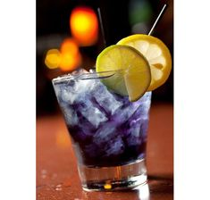 Purple People Eater: 1 1/4 oz. Captain Morgan 1/2 oz. blue Curacao Splash cranberry juice Splash Sprite Splash pineapple juice Lemon garnish