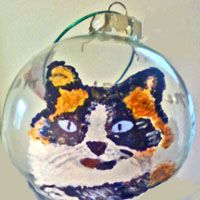 Calico Cat Christmas Ornaments For The Cat Lover. Our hand painted Calico glass Christmas cat ornaments catch the colors of these beautiful felines and make great cat lover gifts.  $28.00