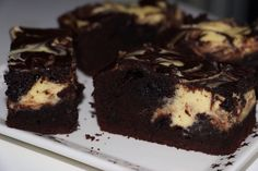 Used the following recipe, but instead of bites did a slice, so yum especially served warm! http://www.justataste.com/2012/04/cheesecake-brownie-bites/