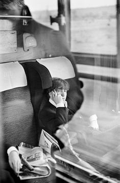 The BEATLES during filming of 'A Hard Days Night'. John Lennon relaxing on the train, in between takes, during the filming of 'Hard Days Night'. 1964. By David Hurn #Beatles #JohnLennon