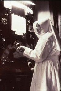 Sister Beatrice, the first Registered Technologist, at the controls. Things were a little different back then.