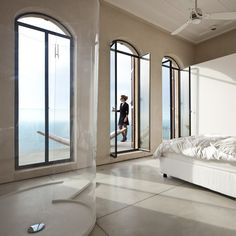 Bedroom view of the renovated Jaffa Flat by Pitsou Kedem. Nice arched windows.