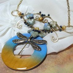 circle washer with wirework and bead embellishment pendant
