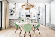 mint green chairs and a woven pendant in the casual breakfast nook | fresh pattern and color house tour on coco kelley