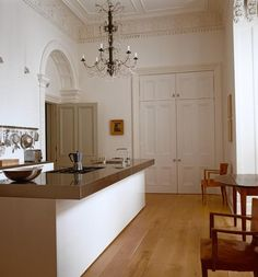 """Sara Ruffin Costello writes of Jasper Conran's kitchen in the WSJ: """"The ratio of modern stainless counter to old-lady molding in this kitchen makes a formidable statement."""""""