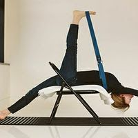 crossleg forward bend with chair keeps your chest open