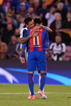 Barcelona's Brazilian forward Neymar (R) is comforted by Juventus' Brazilian defender Dani Alves after their disqualification by Juventus at the end of the UEFA Champions League quarter-final second leg football match FC Barcelona vs Juventus at the Camp Nou stadium in Barcelona on April 19, 2017..The game ended with a draw and Juventus is qualified for the semis. / AFP PHOTO / Josep LAGO