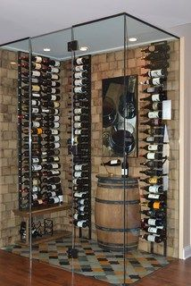 Gorgeous wall mounted wine racks in Wine Cellar Contemporary with Whiskey Barrel Bar next to Small Home Bar alongside Whiskey Barrel Ideas and Wine Barrel Table Whiskey Barrel Bar, Wine Barrel Table, Wine Vault, Small Bars For Home, Modern Wine Rack, Barrel Ceiling, Home Wine Cellars, Wine Cellar Design, Wine Rack Wall