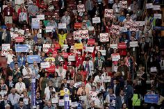 Delegates and attendees in support of Sen. Bernie Sanders (I-VT) hold up signs on the first day of the Democratic National Convention at the Wells Fargo Center, July 25, 2016 in Philadelphia.