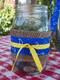 Great detail to add extra lighting as sun goes down.  Mason Jars decorated with burlap and ribbon filled with river rock and nesting grass.