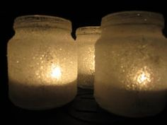 Snow Lantern.  Baby food jars covered in wood glue and rolled in sugar.  Tea lights inside.