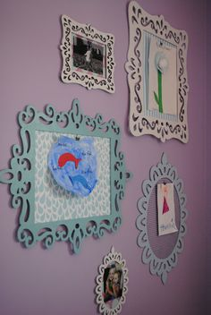 laser cut frames from Michaels, cheap! just paint and hang