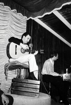 João Gilberto on guitar with João Donato on keyboard.