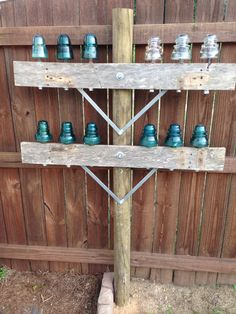 Glass Insulator display pole in our back yard. Put two of these in chicken coop with sitting area in between (Chicken Backyard Ideas) Electric Insulators, Insulator Lights, Glass Insulators, Outdoor Projects, Garden Projects, Diy Projects, Backyard Sitting Areas, Chicken Coop Decor, Chicken Coops