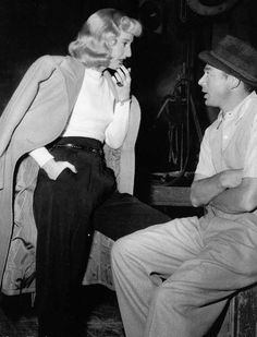 """Barbara Stanwyck and Billy Wilder discussing her next scene in """"DOUBLE INDEMNITY"""" (1944)."""