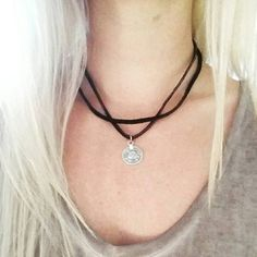 Check out this item in my Etsy shop https://www.etsy.com/listing/464123049/black-leather-choker-with-coin-pendent