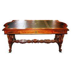 Beautiful long walnut Victorian writing table attributed to Thomas Brooks. Price includes restoration and your choice of leather.
