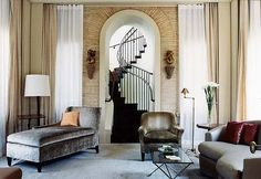 love the brick doorway to the spiral stair