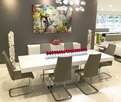 Your art will always look better and have greater impact in the space when the decor supports the art. In this case, the white Astoria dining table and white Morgan Buffet created a great color balance between the artwork, the furniture and accessories increasing its impact in the room.
