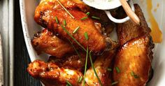 Here's a party trick that's guaranteed to please a crowd – a platter piled high with golden, maple sticky chicken wings.