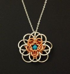"""This necklace kit, combines a chainmaille flower I call, """"She Loves Me, She Loves Me Not"""" with a simple silver plated chain. I have selected non tarnish copper"""