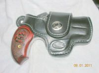 Bond Arms Driving Holster Review  Model 631519      Premium leather holster. Fully lined. Finely appointed with retention strap. Perfect for those who spend a lot of time behind the wheel of a vehicle. Barrel length fits the Snake Slayer derringer.