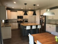 Kitchen refinished in SW pure white, island in SW grizzle gray by Chameleon Painting SLC UT. Laundry Room Cabinets, Kitchen Cabinets, Slc, Chameleon, Pure White, Island, Pure Products, Gray, Pictures
