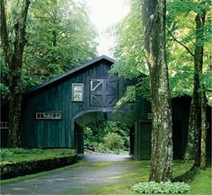 I have always wanted a long, winding driveway thru an old barn and across a small stream. Always.