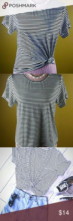 """Dressy Black and White Striped Tee Woman- M  NWT Dressy Black and White Striped Tee Woman- M  NWT Soft Cotton/Rayon Blend. Perfect for layering or by itself.  PLEASE - check size measurements. Fits more like a small/ Tight medium.   Medium- Bust 34.5"""" Length- 22.5""""  All reasonable offers welcome, no trades. Feel free to bundle with other items in my closet for a larger discount. Happy Poshing! Tops Tees - Short Sleeve"""