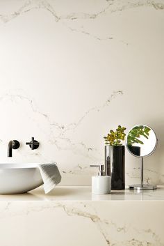 Statuario Nuvo - Caesarstone's interpretation of Statuario marble; Statuario Nuvo brings you refined yet impressive dark veins on a white background, enriched with a delicately diffused subsurface vein structure.